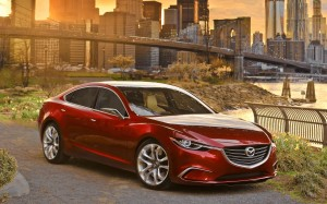 Desktop Wallpaper: Red Mazda Sedan Park...