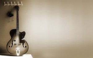 Desktop Wallpaper: Guitar Leaning On Wa...
