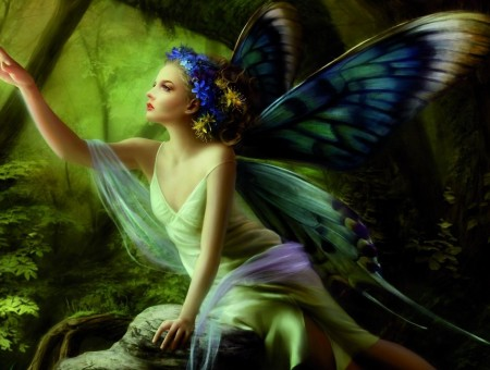 Painting Of A Fairy In A Green Dress With Blue White And Green Wings Sitting On A Rock With Her Arm Outstretched