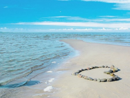 Stones On The Shore Formed A Heart During Daytime