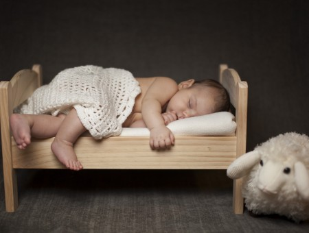 Baby Sleeping On Bed With White Blanket