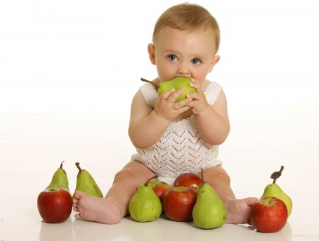 Baby Sitting Surrounded By Pear And Apple On Floor