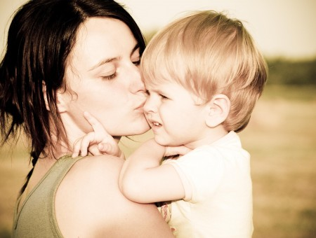 Woman In Grey Tank Top Kissing Baby