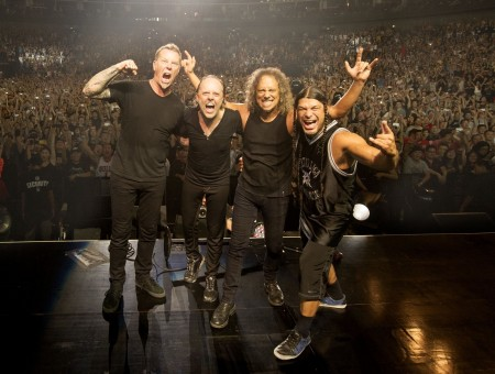 Metallica Band On Stage With Crowd Of People At Their Back