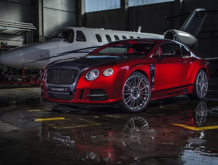Red 2 Door Bentley Coupe In Airplane Hangar