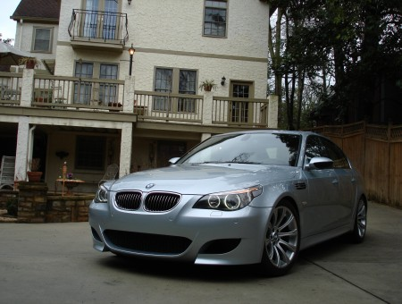 Grey BMW Sedan Parked Near House