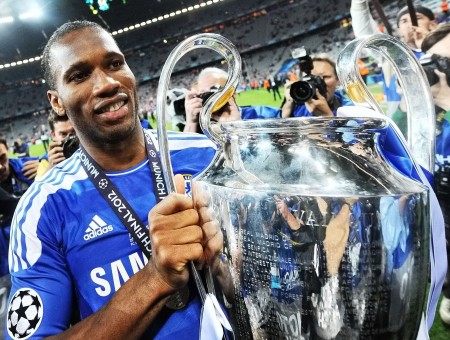 Man In Adidas Samsung Jersey Holding Silver Trophy