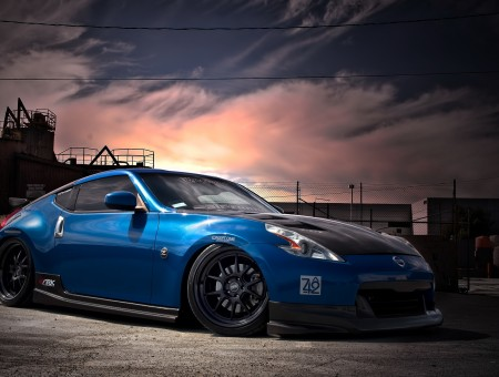 Blue Nissan 370z Coupe On Gray Pavement