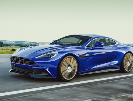Blue Aston Martin Sports Coupe On Road