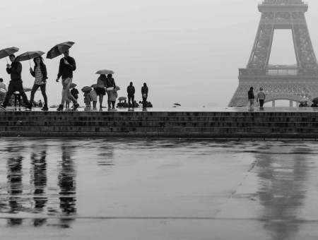Group Of People Near Eiffel Tower In Grayscale Photo
