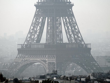 Eiffel Tower Surrounded With Buildings Covered With Fog During Daytime