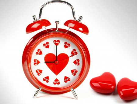 Red Heart Printed Alarm Clock Beside Red Hearts Ornament