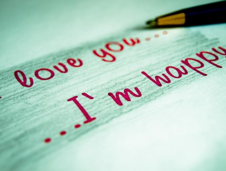 I Love You.. I'm Happy Labeled Paper Beside Black Ballpoint Pen