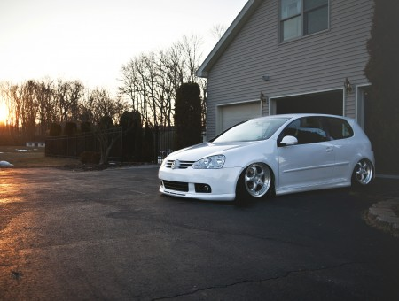 White Volkswagen Golf Parked On Driveway