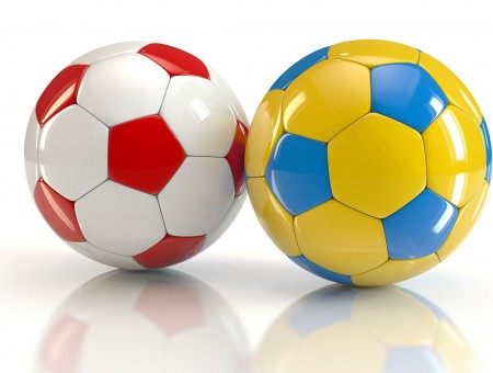White Red Ball Beside Yellow Teal Ball