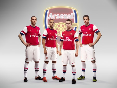 4 Men Standing In Front Of Arsenal Logo
