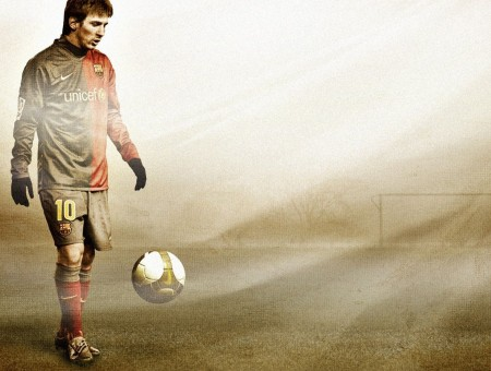 Man In Brown And Red Unicef Nike Soccer Long Sleeved Fc Barcelona Shirt Standing In Front Of Soccer Ball Bouncing