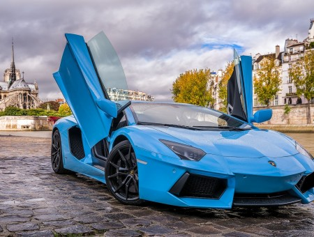 Blue Lamborghini Aventador With Doors Open On City Street
