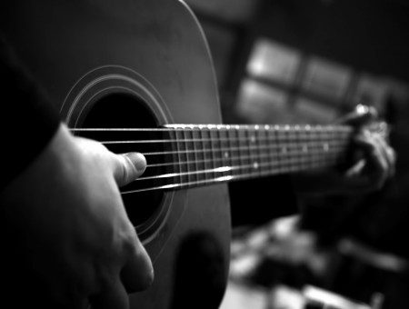 Person Playing Acoustic Guitar Greyscale Photography