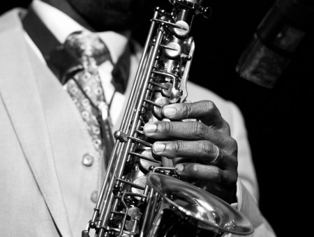 Grayscale Photo Of A Man Holding A Saxophone