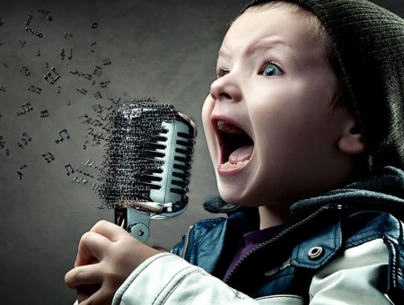 Boy Holding Silver Microphone