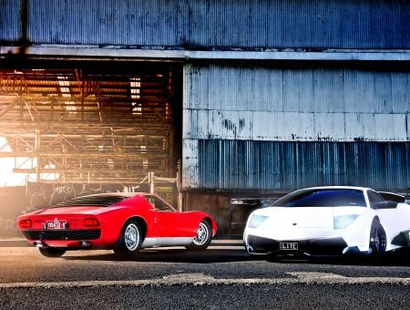 Red Lamborghini Miura Next To White Lamborghini Murcielago