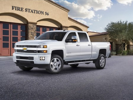 White Chevrolet Silverado Park Beside Fire Station Building During Daytime