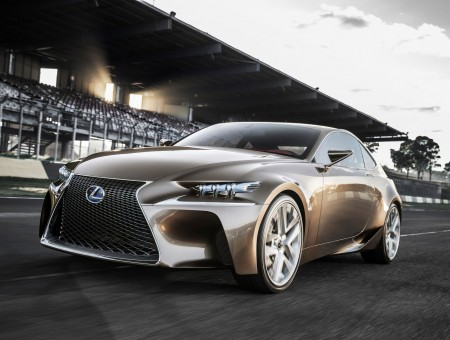Brown Lexus Sports Coupe On Race Track