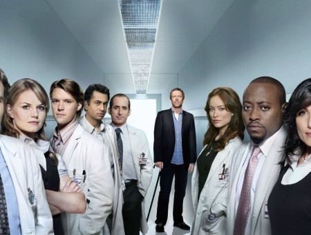 House Characters In A White Hallway