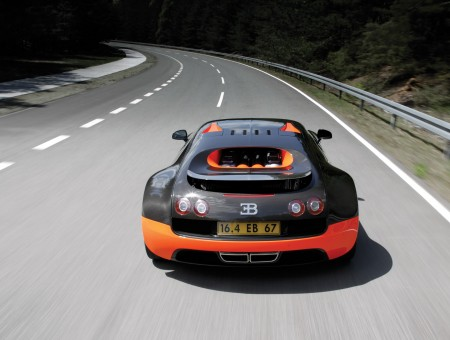 Black And Orange Bugatti Veyron On Road During Daytime