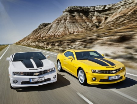 Chevrolet Camaros On Road By Mountains