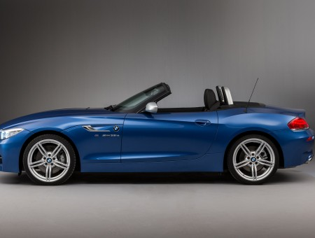 Blue Convertible Car On Gray Ground