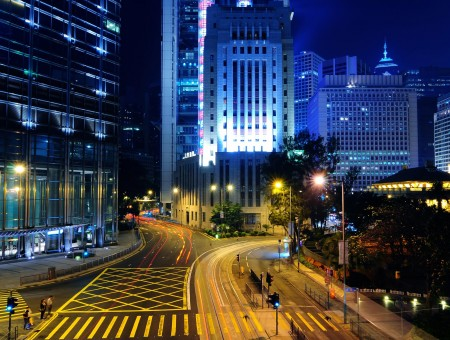 View Of City Building With Gray Asphalt Road During Night Time