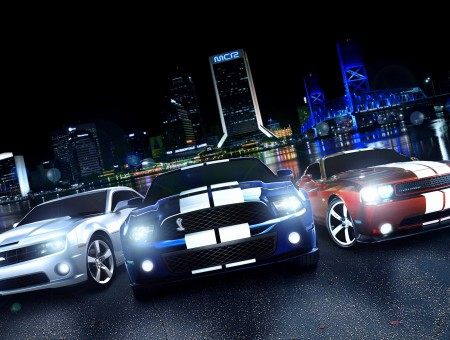 3 Muscle Cars On Black Asphalt Road During Night Time