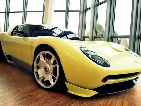 Yellow Lamborghini Miura On Display Inside Curtain Wall Building During Daytime