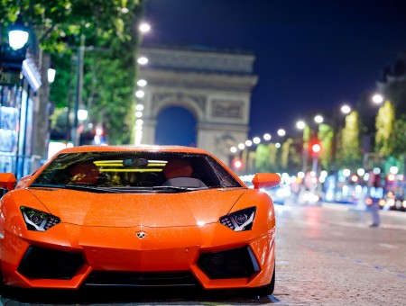 Orange Lamborghini Aventador On Street During Night Time