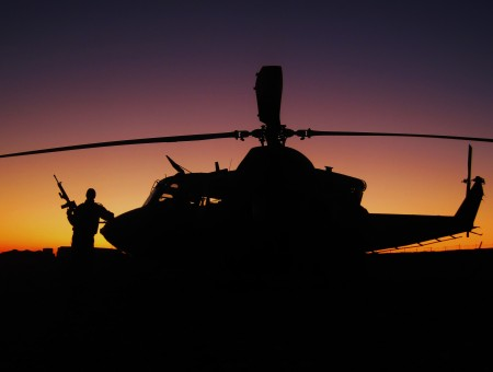 Silhouette Of Helicopter During Sunset