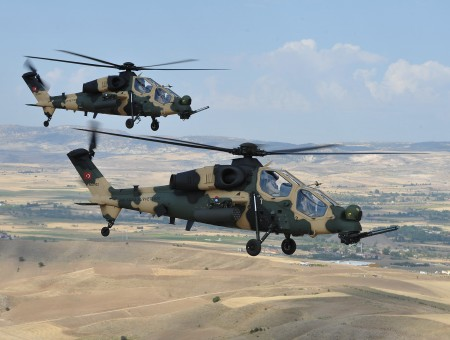 Brown And Green Apache Helicopters In Mid Air