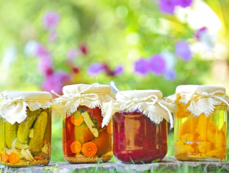 Clear Glass Jar With Fermented Vegetables On The Ground In Macro Photography