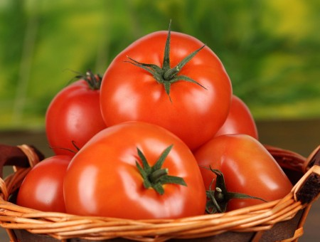 Red Tomato On A Woven Basket