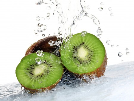 Kiwi Fruit In Water Surface