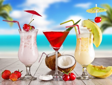 Beverage In Clear Footed Drinking Glasses On Seaside Under Blue And Cloudy Sky During Daytime