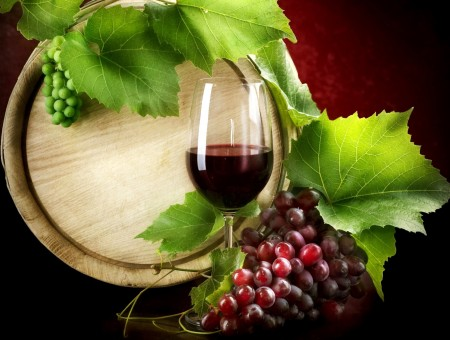 Red Wine Beside Red Grapes