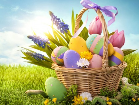 Green Yellow And Purple Egg Inside Of Basket In Blue And White Sky