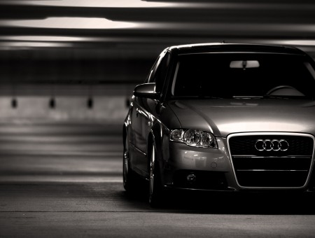 Grayscale Photo Of Audi Sedan Parked On Parking Lot