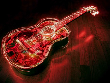 Red Lighted Acoustic Guitar On Floor