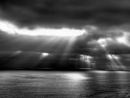 Sun Rays Passing Through Thick Clouds Over Sea Grayscale Photography
