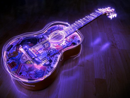 Black And Purple Guitar With Lights On Brown Wooden Parquet Floor