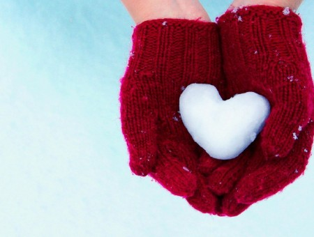 Person In Red Hand Gloves Holding Heart Shape Made Frome Snow