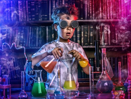 Boy experimenting chemicals in a laboratory